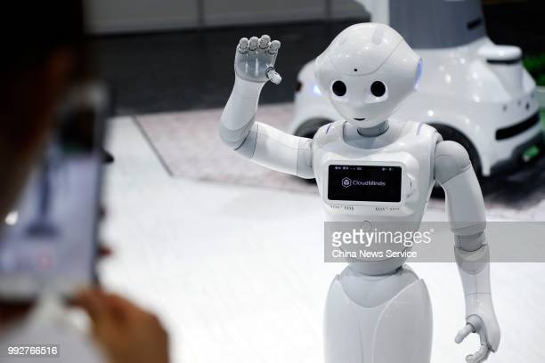 An AI robot by CloudMinds is on display on the opening day of the China International Robot Show 2018 at National Exhibition and Convention Centre on...