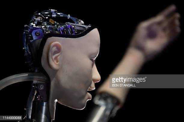 An AI robot with a humanistic face, entitled Alter 3: Offloaded Agency, is pictured during a photocall to promote the forthcoming exhibition entitled...