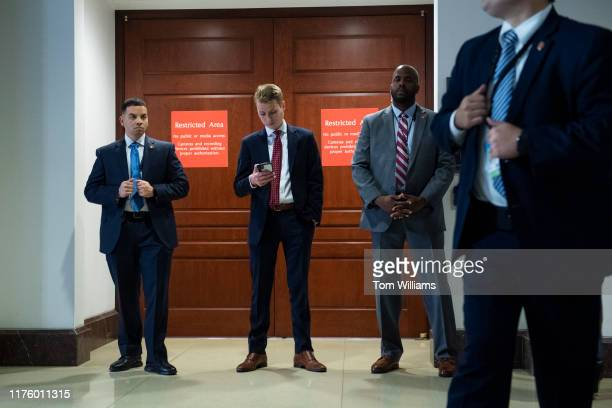 An aide and security for House Minority Leader Kevin McCarthy RCalif stand outside the deposition of George Kent the deputy assistant secretary of...