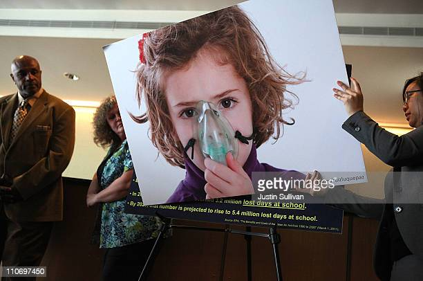 An aide for US Sen Barbara Boxer sets up a photograph of a child with asthma during a press conference on March 23 2011 in San Francisco California...