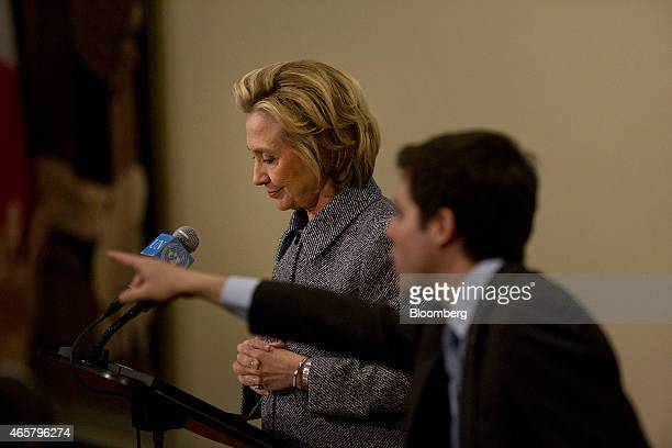 An aide selects a reporter to ask Hillary Clinton former US secretary of state a question during a news conference at the United Nations in New York...