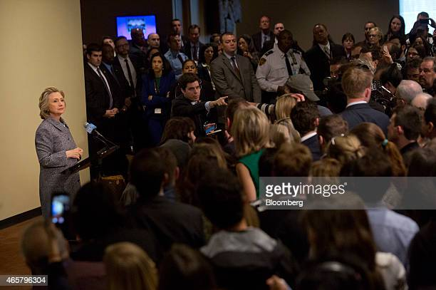 An aide selects a reporter to ask Hillary Clinton former US secretary of state left a question during a news conference at the United Nations in New...