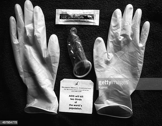 An AIDS protection pack from the Rajneesh Medical Corporation containing latex gloves, a condom and HR lubricating jelly, Oregon, USA, circa 1984....