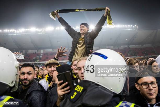 An AIK supporter holds up a scarf during an Allsvenskan match between Kalmar FF and AIK at Guldfageln Arena on November 11 2018 in Kalmar Sweden