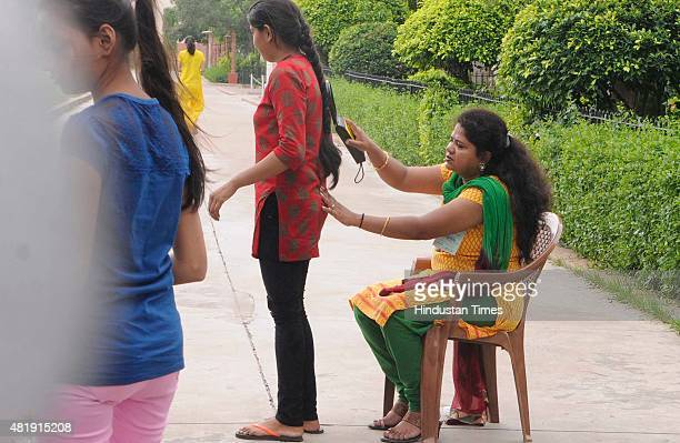 An AIPMT aspirant undergoes security check at the entrance of Examination center at a school during All India Pre Medical/Pre Dental 2015 retest on...