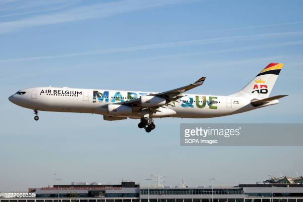 An Air Belgium airbus 340300 promoting its regular destination to Martinique island is seen landing at Charleroi airport