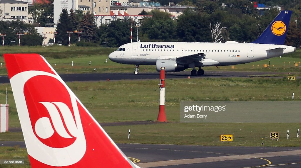 An Air Berlin airplane (L) is seen on the tarmac at Tegel Airport (TXL) as a Lufthansa plane taxis on August 23, 2017 in Berlin, Germany. Air Berlin's creditors are meeting to discuss acquisition of the insolvent carrier's assets. The airline has been in talks with interested parties since last week after filing for bankrupty when its major shareholder, Etihad, backed out of its funding. Lufthansa, also interested in Air Berlin's Austrian subsidy Niki, Thomas Cook, easyJet and Ryanair are all said to be participating in discussions.