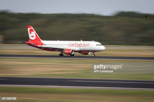 An Air Berlin plane lands at Tegel Airport on August 8 2017 in Berlin / AFP PHOTO / AXEL SCHMIDT