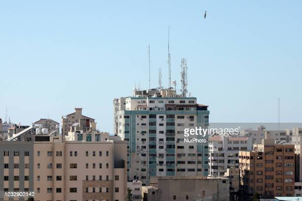 An air bomb hits the Jala Tower during an Israeli airstrike in Gaza city controlled by the Palestinian Hamas movement, on May 15, 2021. - Israeli air...