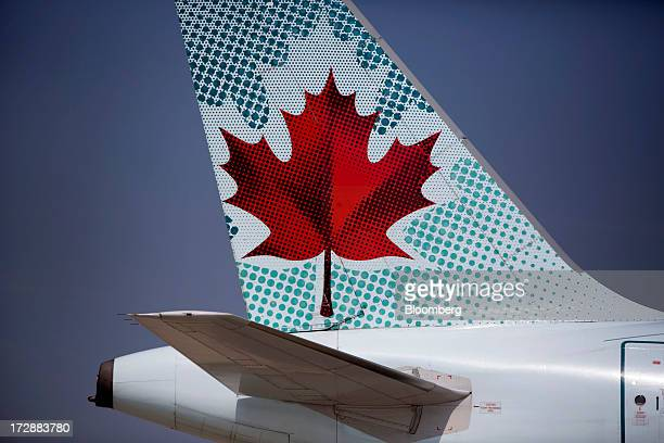 An Air Canada aircraft taxis at Toronto Pearson International Airport in Toronto Ontario Canada on Wednesday July 3 2013 Air Canada predicted further...
