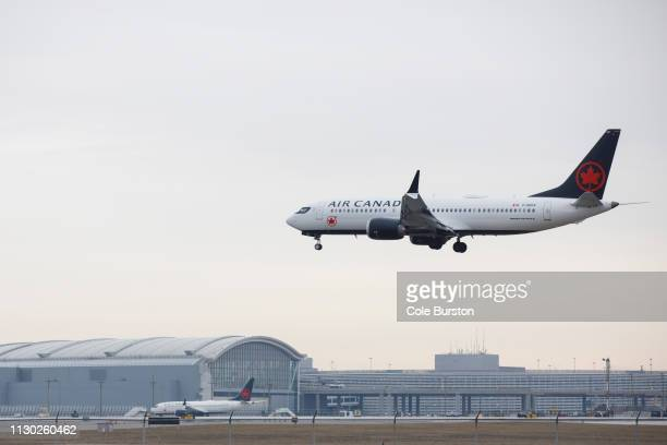 An Air Canada Boeing 737 MAX 8 jet approaches the Toronto Pearson International Airport for a landing on March 13 2019 in Toronto Canada US President...