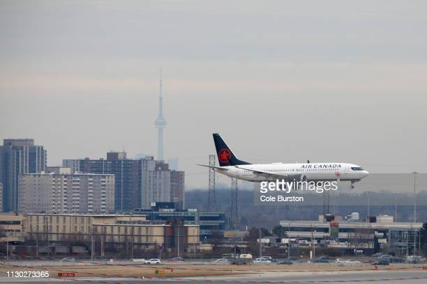 An Air Canada Boeing 737 MAX 8 jet approaches Toronto Pearson International Airport for landing on March 13 2019 in Toronto Canada US President...