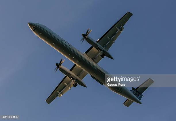An Air Canada Bombardier Q400 turboprop jet aircraft is on approach to the City Airport on July 1 2014 in Toronto Ontario Canada Canada's most...