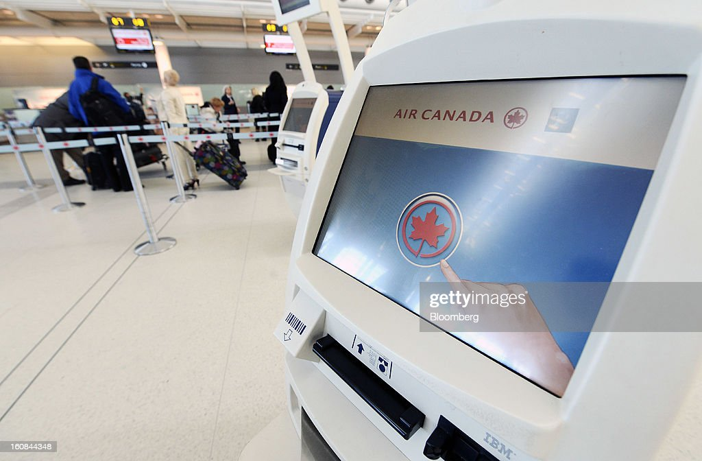 An Air Canada check-in kiosk sits at Pearson International Airport in Toronto, Ontario, Canada, on Wednesday, Feb. 6, 2013. Air Canada, the country's biggest carrier, is scheduled to announce quarterly earnings data on Feb. 7. Photographer: Aaron Harris/Bloomberg via Getty Images