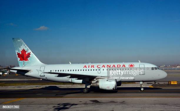 An Air Canada Express passenger jet lands at LaGuardia Airport in New York New York