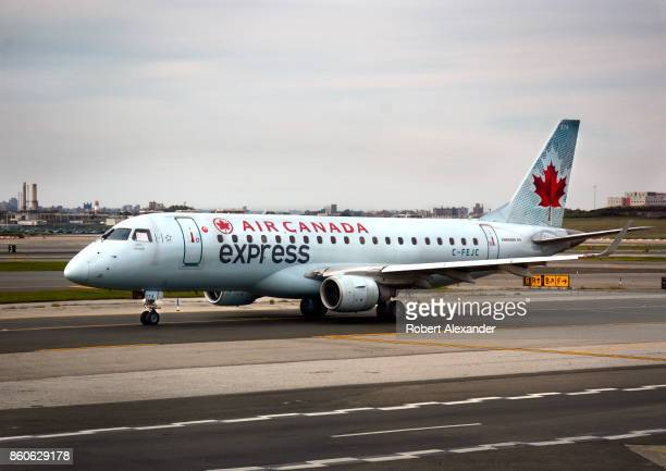 An Air Canada Express passenger jet taxis at LaGuardia Airport in New York New York