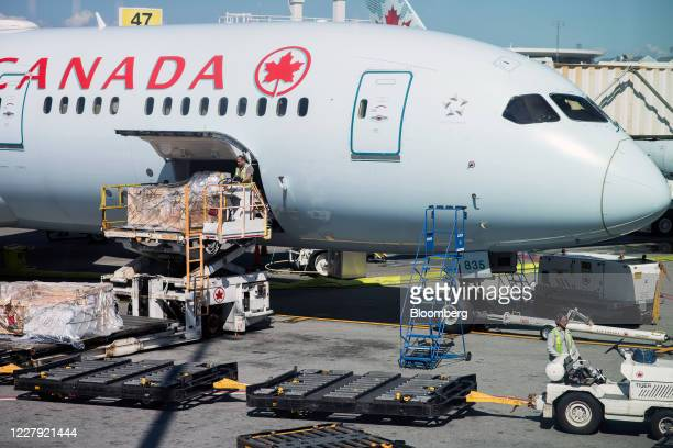 An Air Canada plane is loaded on the tarmac at Vancouver International Airport in Vancouver, British Columbia, Canada, on Tuesday, Aug. 4, 2020. Data...