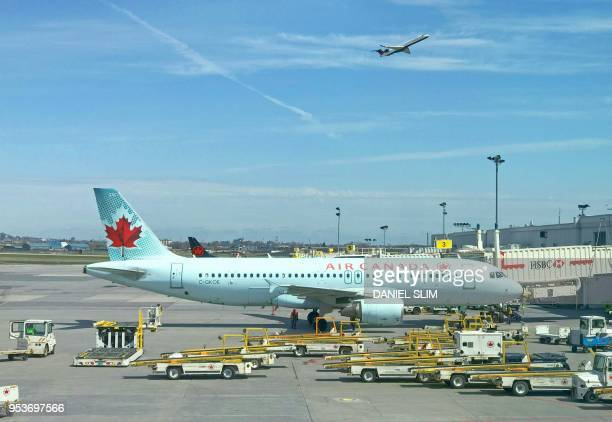 An Air Canada plane sits on the tarmac at Trudeau airport near Montreal Canada May 1st 2018