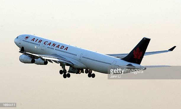 An Air Canada plane takes off from Heathrow Airport December 19 2002 in London England The British Government announced today that armed 'air...
