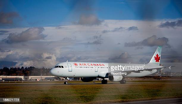 An Air Canada plane taxis the runway at Vancouver International Airport in Richmond British Columbia Canada on Wednesday Nov 13 2013 The number of...