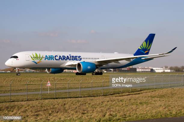 An Air Caraïbes Atlantique Airbus 350900 taxiing to departure to the Overseas beaches