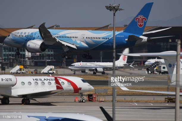 An Air China Boeing 737 MAX 8 plane is seen as a China Southern Airlines Boeing 787 lands at Beijing Capital Airport on March 11 2019 China on March...