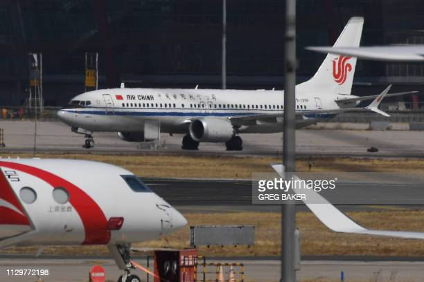 An Air China Boeing 737 MAX 8 plane is seen at Beijing Capital Airport on March 11 2019 China on March 11 2019 ordered domestic airlines to suspend...