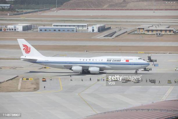 An Air China Boeing 7478 aircraft stands on the tarmac at Beijing Daxing International Airport on May 13 2019 in Beijing China Four planes...