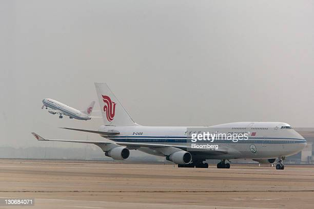 An Air China Ltd airplane burning a mixture of jet fuel and bioliquid fuel taxis after landing at Beijing Capital International Airport in Beijing...