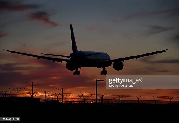 An Air China plane makes its descent over the city of Inglewood as it prepares to land at Los Angeles International Airport California on January 24...