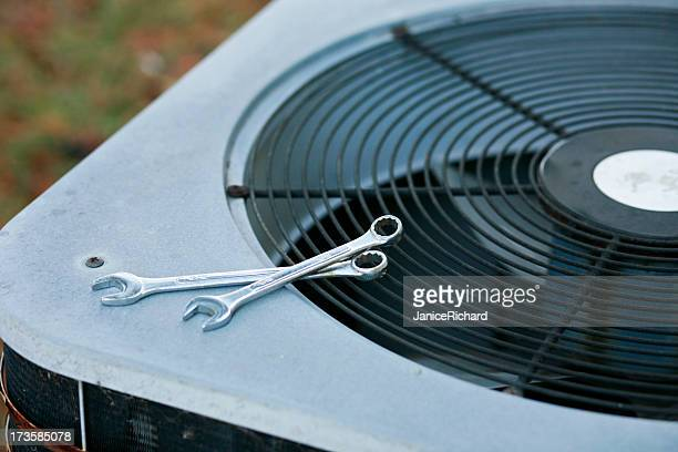 an air conditioner being fixed - hvac stock photos and pictures