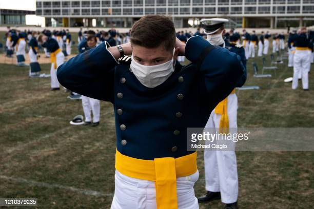 An Air Force Academy cadet adorns a mask after a graduation ceremony on April 18 2020 in Colorado Springs Colorado Saturday's graduation which was...