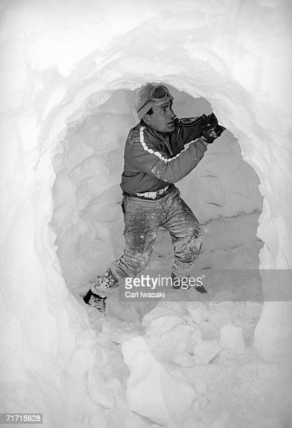 An Air Force Academy cadet instructor shores up a wall in a snow cave near Loveland Pass Colorado February 4 1963