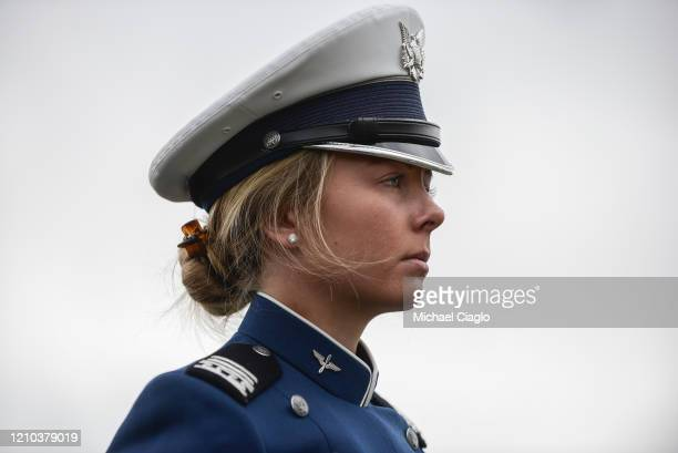 An Air Force Academy cadet stands at attention during her graduation ceremony on April 18 2020 in Colorado Springs Colorado The graduation which was...