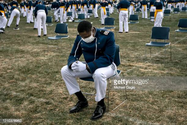 An Air Force Academy cadet takes a moment to himself after graduating from the academy on April 18 2020 in Colorado Springs Colorado Saturday's...