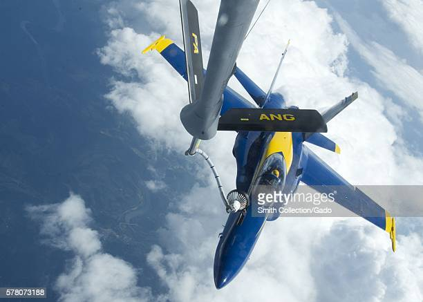 An Air Force KC135 from the 171st Air Refueling Wing fuels an F/A18 Hornet flown by Lt CJ Sugarloaf South Carolina 2012 Image courtesy Mass...