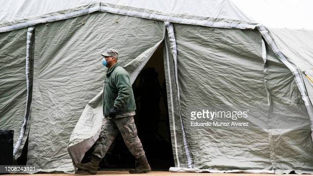 An Air Force member exits a tent builded as makeshift morgue outside of Bellevue Hospital on March 25 2020 in New York City New York Across the...
