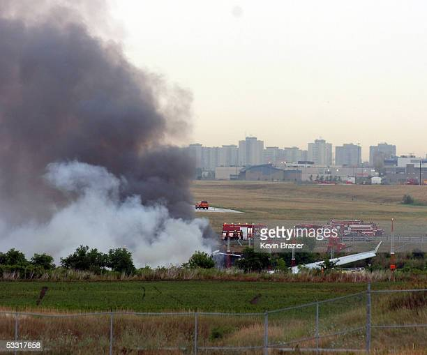 An Air France A340 burns after running off the runway at Pearson International Airport August 2 2005 in Toronto Canada All 297 passengers and 12 crew...