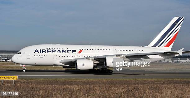 An Air France A380 the world's largest civilian airliner takes off on November 20 2009 at Roissy CharlesdeGaulle airport outside Paris on its first...
