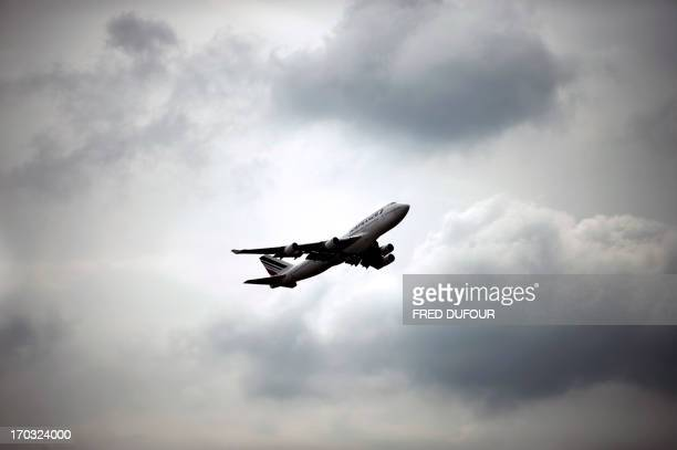 An Air France Boeing 747 plane takes off from Roissy Charles de Gaulle international airport in RoissyenFrance outside of Paris on June 11 2013 AFP...