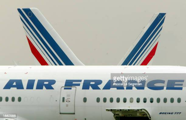 An Air France Boeing 777 is shown at Charles De Gaulle airport March 28 2003 in Roissy France Air France is cutting flights by 7 percent to cope with...