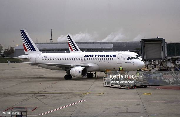 An Air France passenger aircraft is serviced at Charles de Gaulle Airport in Paris France