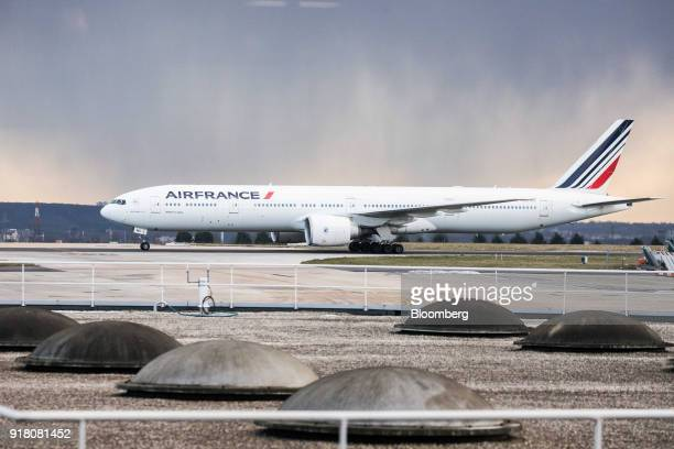 An Air France passenger aircraft operated by Air FranceKLM Group taxis on the runway at Charles de Gaulle airport operated by Aeroports de Paris in...