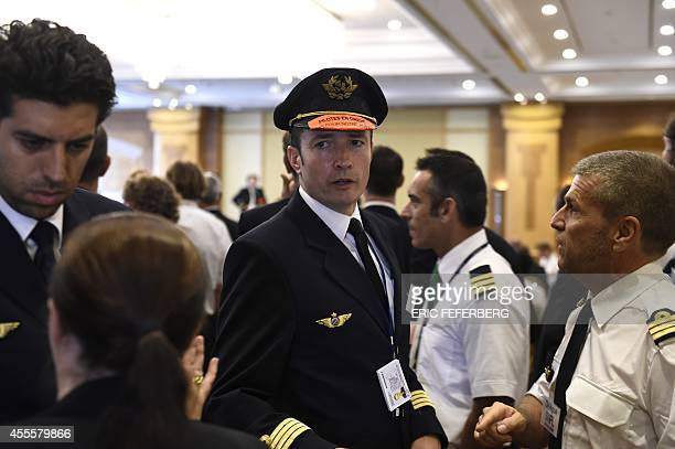 An Air France pilot wearing a sticker on its hat reading Pilots on strike gathers for a meeting called by the pilots's union SNPL near ParisCharles...