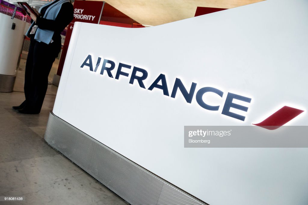An Air France-KLM Group company logo is displayed at the check-in area at Charles de Gaulle airport, operated by Aeroports de Paris, in Paris, France, on Monday, Feb. 12, 2018. Air France will report its full year earnings on Feb 16. Photographer: Christoph Morin/Bloomberg via Getty Images