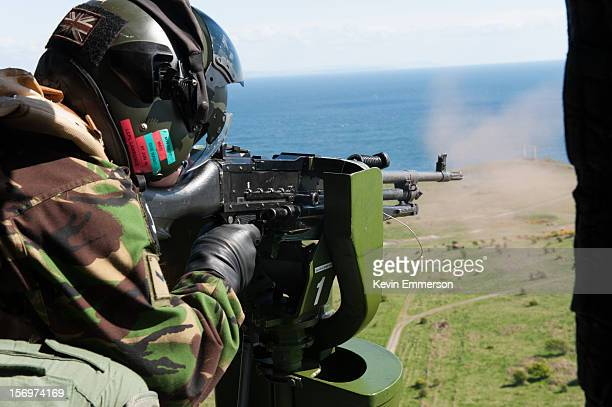 An air gunner fires a General Purpose Machine Gun from an Army Air Corps Lynx AH7 helicopter