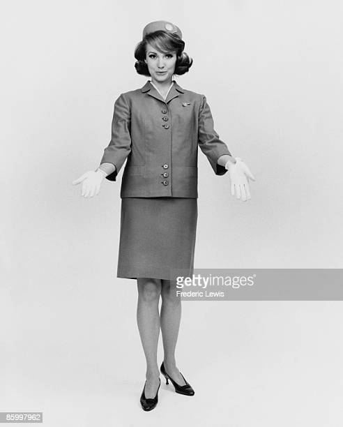 An air hostess in uniform circa 1965