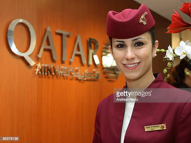 An air hostess of Qatar Airways smiles at the ITB International International tourism fair on March 11 2009 in Berlin Germany The ITB runs from March...