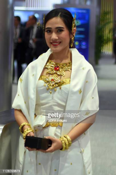 L´HOSPITALET CATALONIA SPAIN An air hostess seen dressed in Indian regional costumes at the Huawei brand conference stand during the Mobile World...