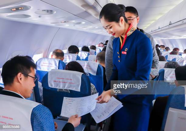 An air hostesses of ARJ21700 provides service for passengers on its first display flight on March 20 2018 in Huhhot Inner Mongolia Autonomous Region...
